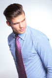 Young business man looks over his shoulder Royalty Free Stock Photography