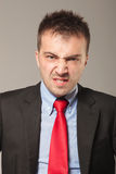 Young business man making a disapproving face Stock Photos