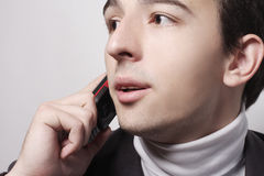 Young business man making a phone call Royalty Free Stock Photos