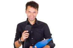 Young business man making statement and declaring on microphone. Young smiling business man making statement and declaring on microphone Royalty Free Stock Images