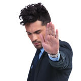 Young business man making the stop hand sign Royalty Free Stock Images