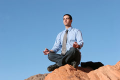 Young business man meditating Stock Photos