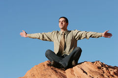 Young business man meditating Stock Images