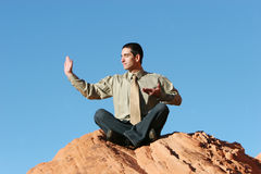 Young business man meditating Royalty Free Stock Photos