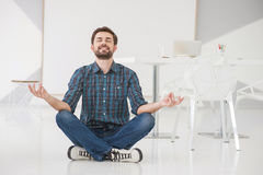 Young business man meditating Royalty Free Stock Image