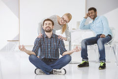 Young business man meditating Royalty Free Stock Photography
