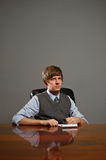 Young Business Man in Meeting Writing in Notepad Stock Image