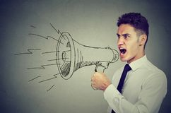 Young business man with a megaphone stock photo