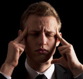 Young business man with migraine Stock Photos