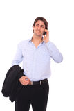 Young business man on mobile phone. Young business man talking on mobile phone Royalty Free Stock Photography