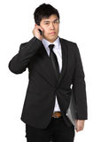 Young business man with mobile phone Royalty Free Stock Photos