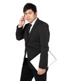 Young business man with mobile phone Royalty Free Stock Photo