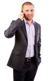 Young business man on mobile phone Stock Photo