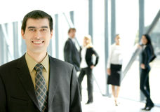 A young business man in a modern office Stock Photography