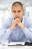 Young Business Man in Office. Looking at camera Royalty Free Stock Photo