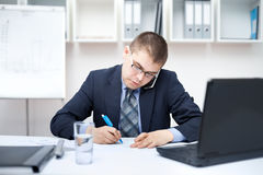 Young business man in the office Royalty Free Stock Photography
