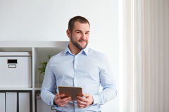 Young business man in office Royalty Free Stock Photos