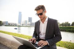 Young business man outdoors work occupation lifestyle. Young business man outdoors work occupation lifestyle Stock Image