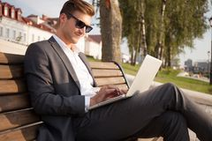 Young business man outdoors work occupation lifestyle. Young business man outdoors work occupation lifestyle Stock Photography
