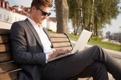 Young business man outdoors work occupation lifestyle. Young business man outdoors work occupation lifestyle Royalty Free Stock Image