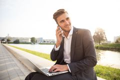 Young business man outdoors work occupation lifestyle. Young business man outdoors work occupation lifestyle Stock Photo