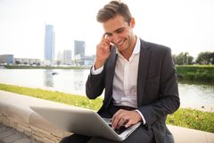 Young business man outdoors work occupation lifestyle. Young business man outdoors work occupation lifestyle Royalty Free Stock Images