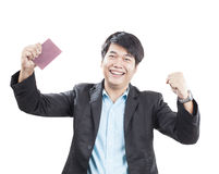 Young business man and passport book. In hand acting happy face to success in thinking isolated white background Royalty Free Stock Images