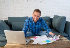Young business man paying bills stock photography