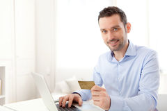 Young business man paying online with credit card royalty free stock photo