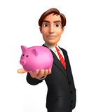 Young Business Man with piggy bank Royalty Free Stock Image