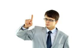 Young business man pointing at something Stock Photo