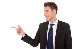 Young Business Man Pointing To The Side Royalty Free Stock Photo
