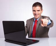 Young business man points from behind laptop Stock Photography