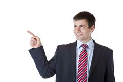 Young business man points with finger ad copyspace Royalty Free Stock Photos