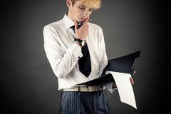 Young business man pondered Stock Photo