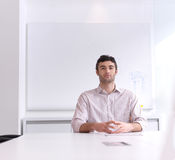 Young business man portrait  at modern office Stock Photos