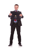 Young business man presenting his briefcase Stock Photos