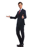 Young business man presenting and making the ok sign Royalty Free Stock Photo