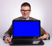 Young business man presents his laptop Stock Photo
