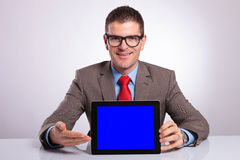 Young business man presents his tablet Royalty Free Stock Images