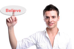 Young business man presses the believe key Stock Photography