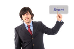 Young business man presses the start button Royalty Free Stock Image