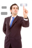 Young business man pressing a touchscreen button Royalty Free Stock Images