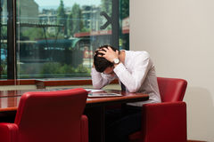 Young Business Man With Problems In The Office Royalty Free Stock Photos