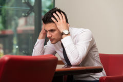 Young Business Man With Problems In The Office Royalty Free Stock Photography