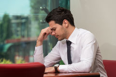 Young Business Man With Problems In The Office Royalty Free Stock Image