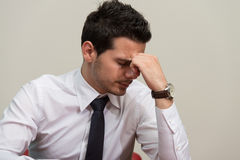 Young Business Man With Problems In The Office Stock Photography