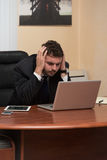 Young Business Man With Problems In The Office Stock Photos