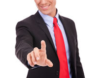 Young business man pushing a button Stock Image