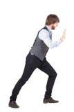 Young business man pushing Stock Photos